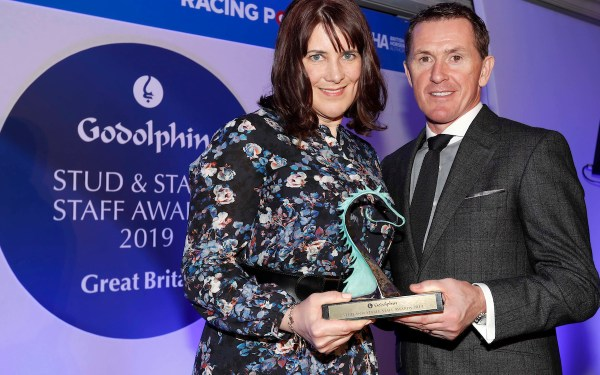 Sir AP McCoy presenting Andrea O'Keeffe with The Godolphin Rory MacDonald Community Award