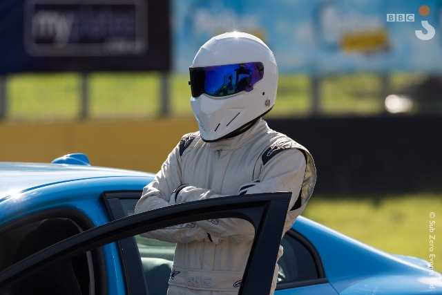 Picture Shows: The Stig stands next to a car at the Top Gear Sydney festival.