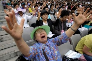 A South Korean Christian woman prays during a service to mark the 60th anniversary of the June 25 Korean War at the World Cup Stadium in Seoul, Tuesday, June 22, 2010. More than 30,000 Christians congregated for prayers for a peaceful solution over North Korea's nuclear weapons programs and hope for an early reunification of the divided Koreas. (AP Photo/Ahn Young-joon)