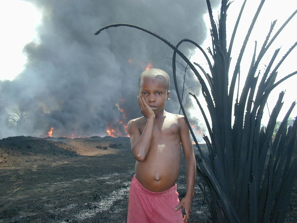 Child near an oil spill