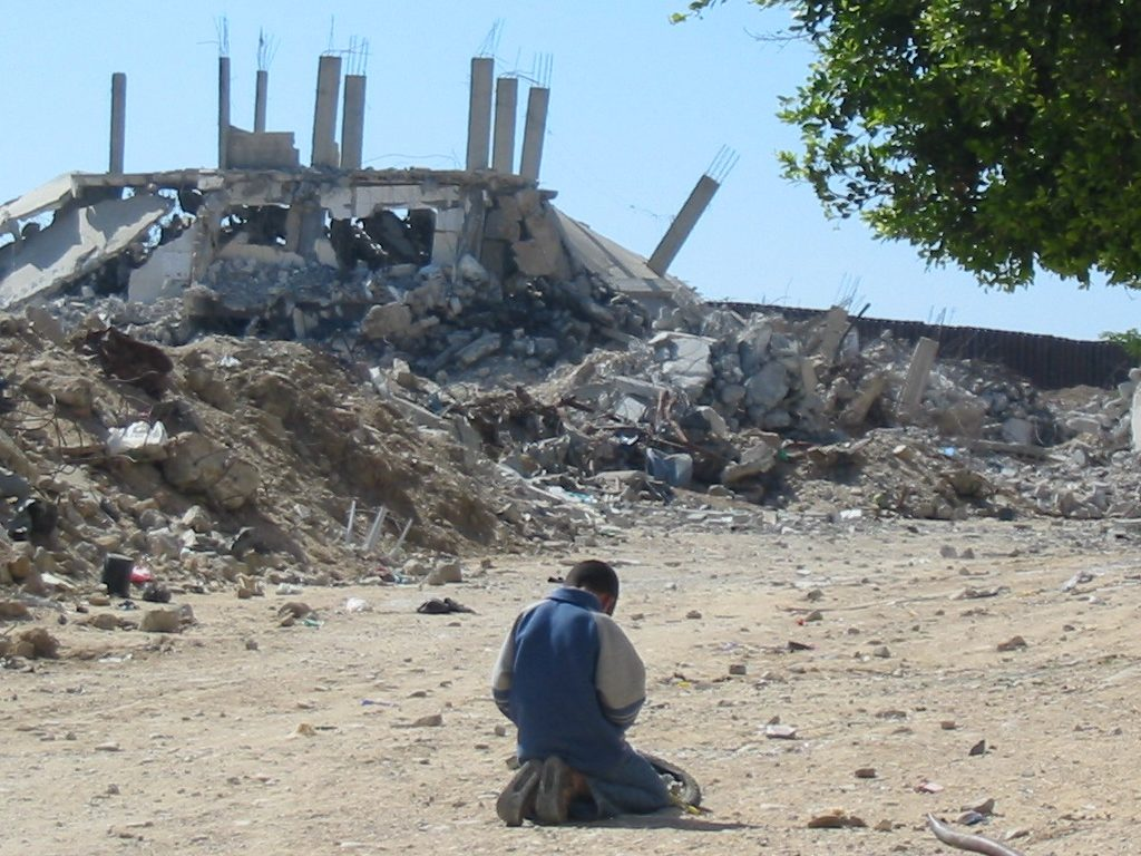 Boy amidst rubble in Gaza
