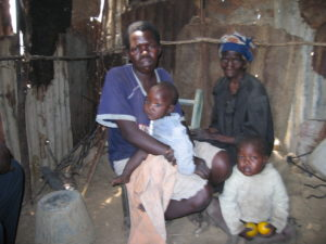 Ncedisani Mpofu, her mother and two of her children in their temporary hut
