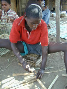 Refugee boy learning carpentry skills