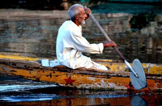 Kashmiri man and his shikara