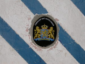 Logo of the Kingdom of the Netherlands outside the Dutch consulate in Bissau