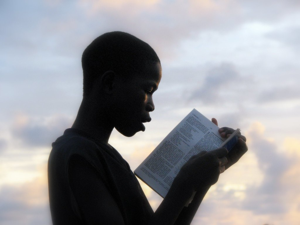 African boy reading