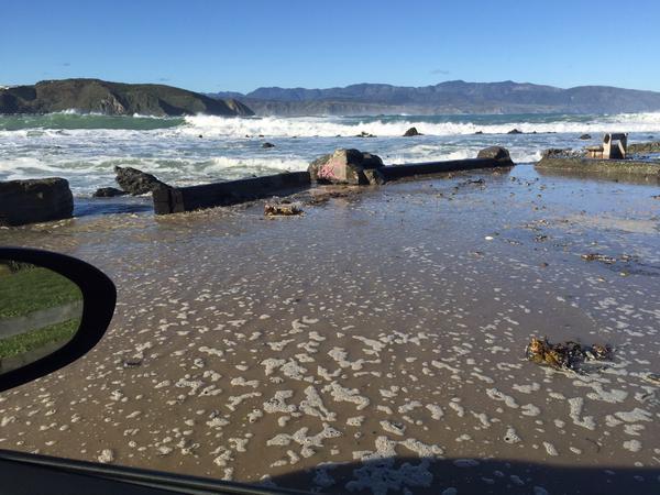 A Lyall Bay carpark awash with sea water.