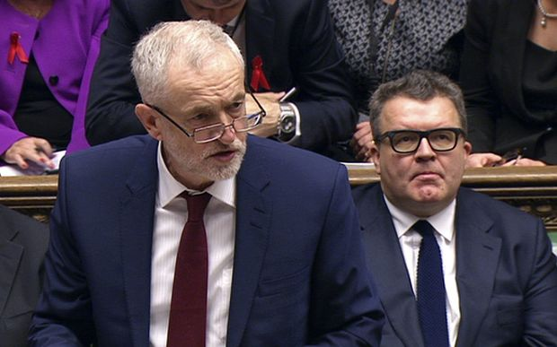 Labour Party Jeremy Corbyn (left) speaking in the House of Commons during the debate on whether the UK should begin bombing IS targets in Syria.