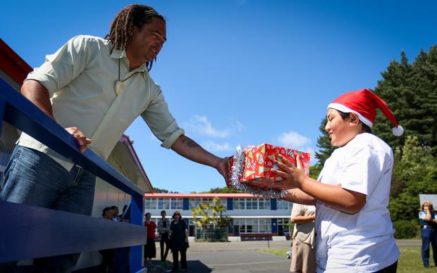 Taipana Hiroti-Teaia is given a present by deputy principal Lester Mohi