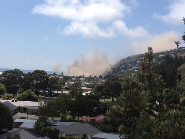 Dust rise seconds after a cliff collapsed in the 5.7 earthquake in Sumner, Christchurch