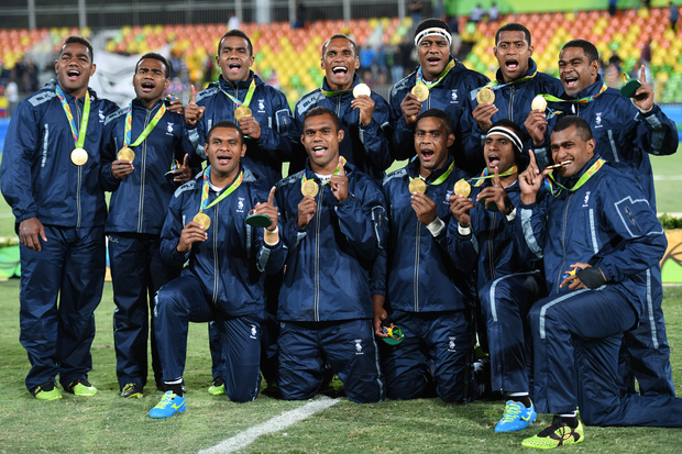 Gold medallists Fiji celebrate during the men's rugby sevens medal ceremony during the Rio 2016 Olympic Games at Deodoro Stadium in Rio de Janeiro onAugust 11, 2016.