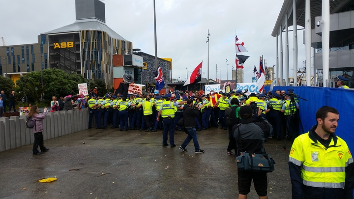 Police are attempting to stop the protesters from crossing a blockade at the Viaduct Events Centre.