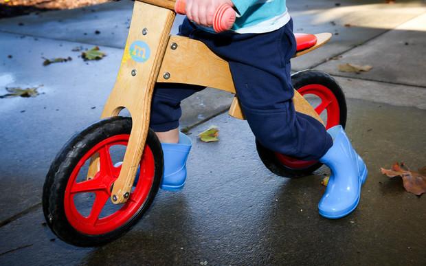 Preschooler on bike.