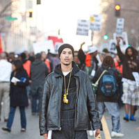 A protestor at a January 2009 demonstration against the killing of Oscar Grant by BART Police in Oakland, CA.