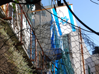 Houses fenced off by wire around the Israeli settlement in Hebron, West Bank.  Photo Credit: Nathan Shepura