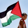 Palestinian child with flag. Image via Flickr (cc) user Rusty Stewart.
