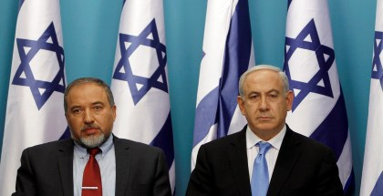 Israel's Prime Minister Netanyahu sits next to Foreign Minister Lieberman after delivering a statement in Jerusalem
