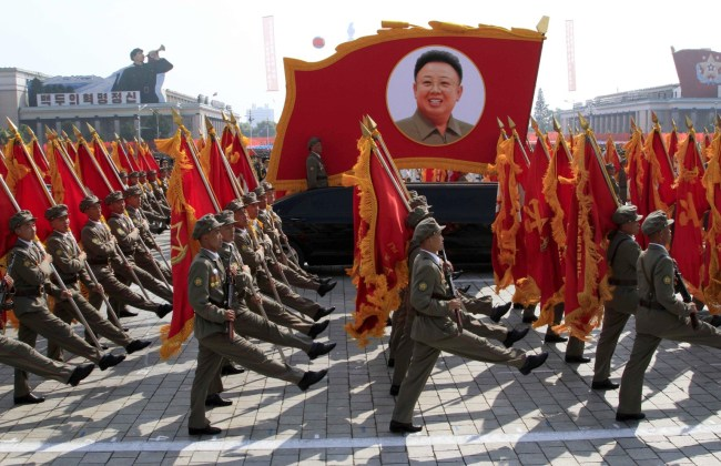 North Korean troops march past a portrait of the late leader Kim Jong Il during a military parade at Kim Il Sung Square to mark the 65th anniversary of the country's founding in Pyongyang, North Korea, Monday, Sept. 9, 2013. (AP Photo/Jon Chol Jin)