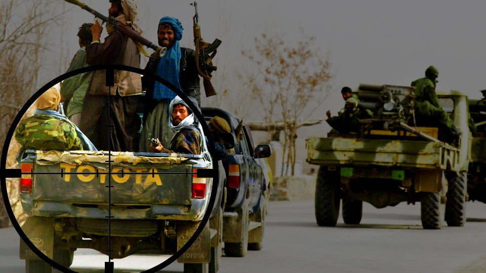 402056 13: Former Northern Alliance soldiers ride a vehicle March 8, 2002 towards the town of Gardez, in Afghanistan. Between 700 to 1,000 soldiers with approximately twenty tanks are moving from Kabul to the capitol of Paktia province. The soldiers are heading to the front line to join the U.S.-led coalition battling against al Qaeda and Taliban forces in the Shah-e-Kot mountain range of eastern Afghanistan. (Photo by Paula Bronstein/Getty Images)