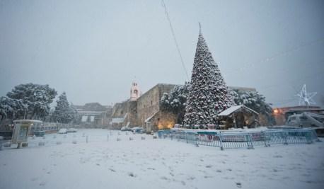 Snow blankets Manger Square in Bethlehem