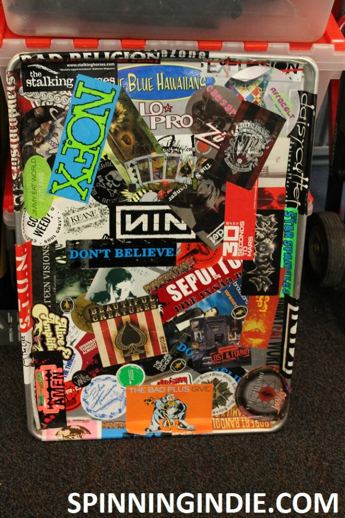 Tray plastered with stickers at college radio station WLOY