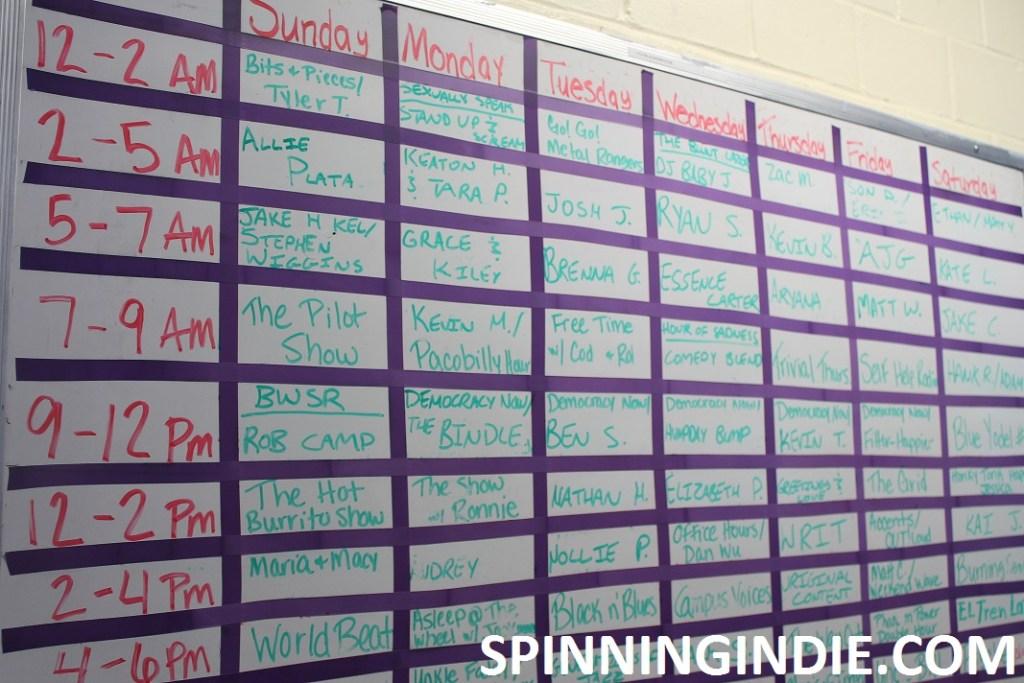white board with WRFL program schedule