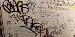 graffiti and signature-covered wall at college radio station KWVA