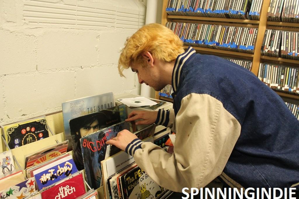 "Alex Edelman looking through 7""s in WMCN record library. Photo: J. Waits"