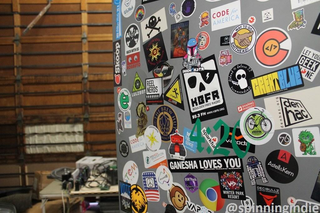 Sticker-covered door at DenHac. Photo: J. Waits