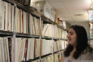 WKCR Station Manager Elizabeth Maghakian eyeing vinyl library. Photo: J. Waits