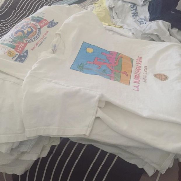 Begin the purge! 15 yrs of race shirts! Should I eBay that #LAMarathon one tho? Lol #decluttering #vvadonation #cottontees