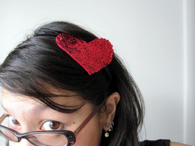 woman wearing heart headband