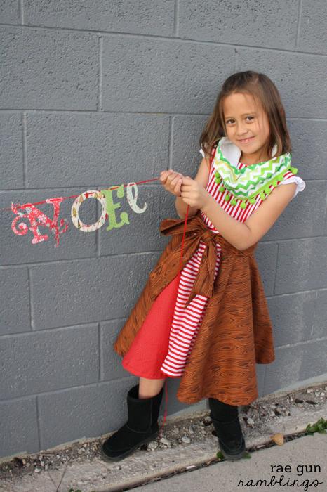 Cute sibling Christmas picture idea with pom pom cowl and christmas banner tutorials - Rae Gun Ramblings