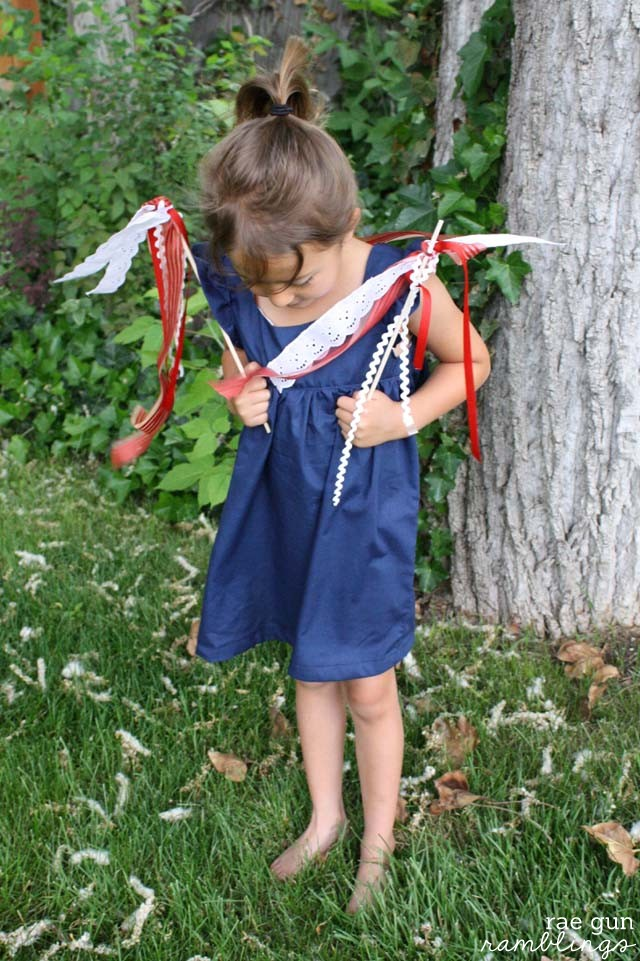 Adorable DIY bohemian babydoll dress and ow to make ribbon wands out of fabric scraps great kid craft project.