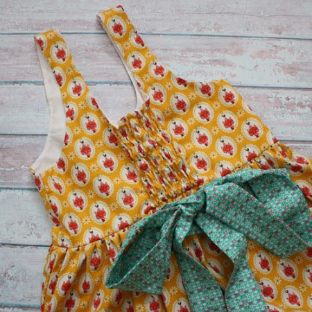 how to easily add an elastic back panel to a dress. great sewing tutorial perfect for kids clothing, maternity wear, or anyone who likes flexible fits and comfort in their clothing.
