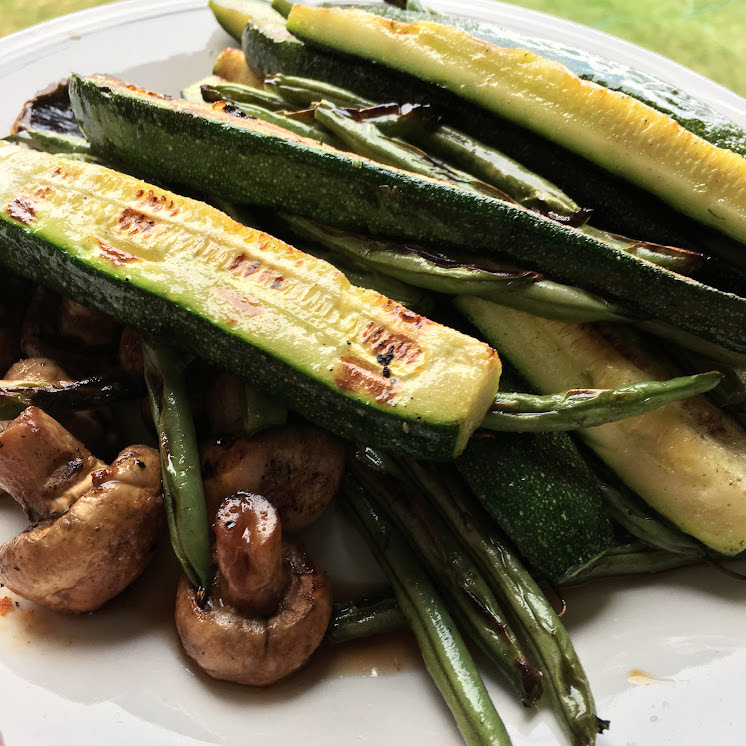 grilled zucchini mushrooms and green beans on plate