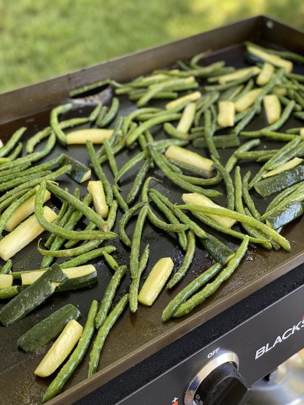 beans and zucchini on griddle
