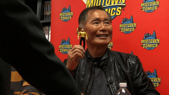 Actor/activist George Takei holds up a Sulu action figure.