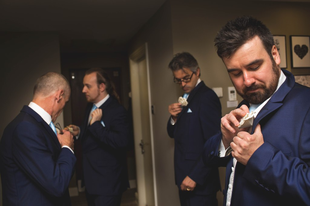 Groom getting ready with ushers