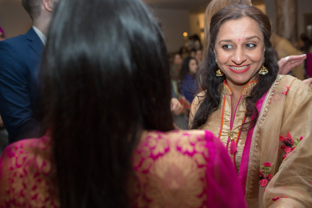 wedding guest smiling at bride