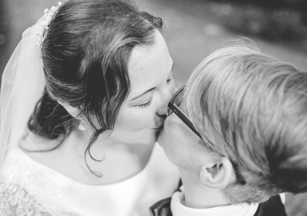 two brides in London kissing