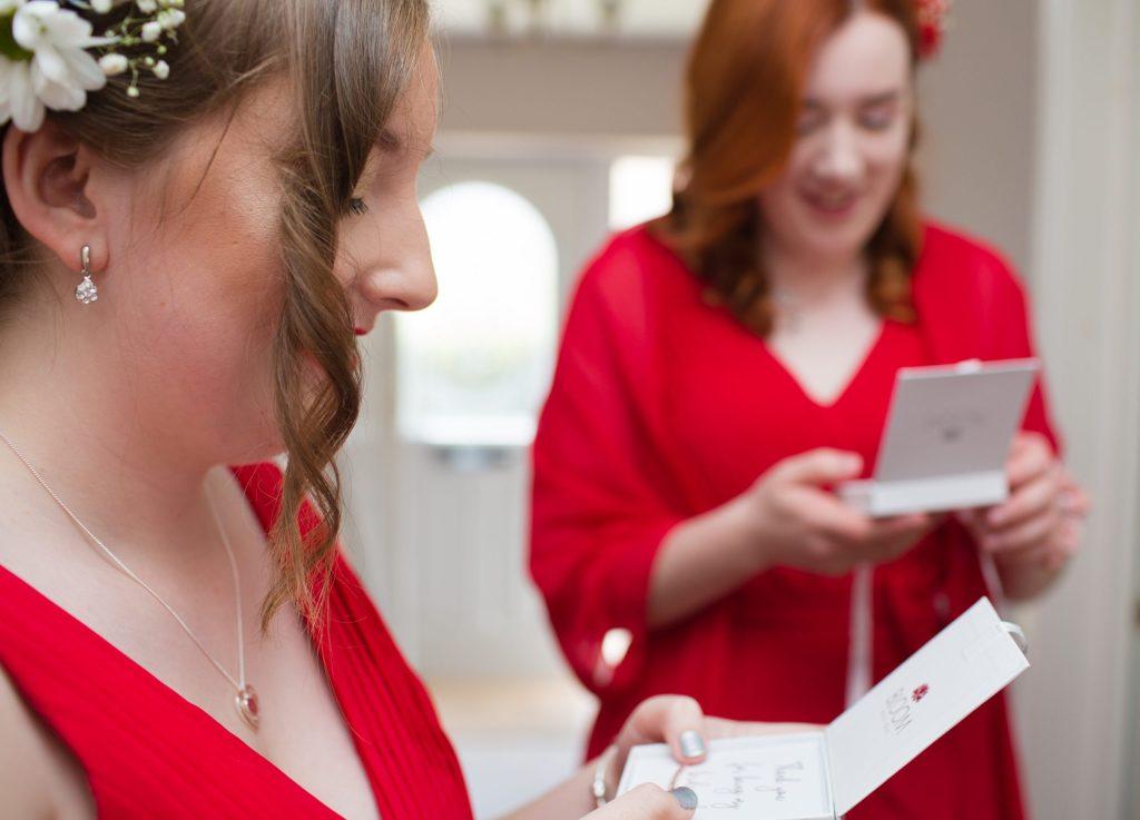 bridesmaids looking at gifts