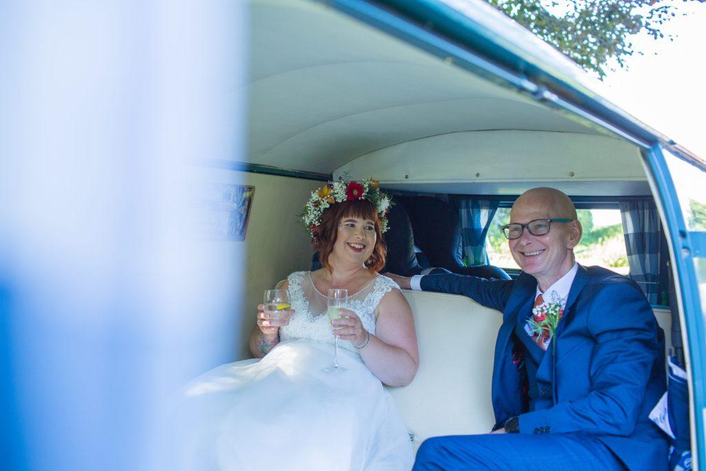 bride and dad sat in back of camper van