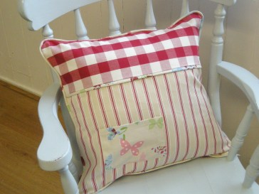 A Pretty Piped Cushion