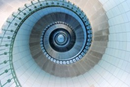 Upside view into the spiral of a lighthouse in France