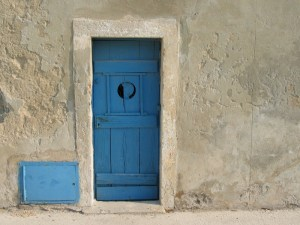 Blue Door Set In Grey Wall