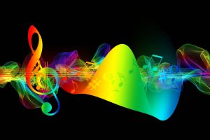 a musical clef with a band of energy all in vibrant and differing colors represn