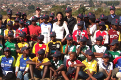 Boston Red Sox owner and MGH Trustee John Henry and his wife Linda visiting the WhizzKids Program in South Africa in 2009