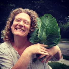 Our friend and supporter Hayley - a happy gardener with her Champion Collard harvest!