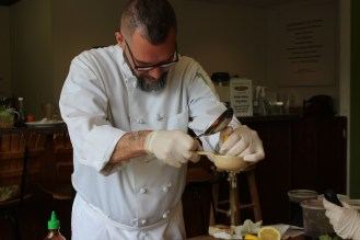 Chef Enrique making the first salad dressing of the workshop.